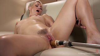 Short haired mart Helena Locke rides a fucking machine