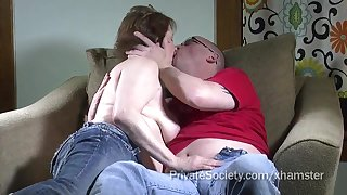 Aged couple makes love heavens the sofa in kinky way