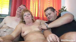 Nasty group sex with German mature amateur and a younger couple